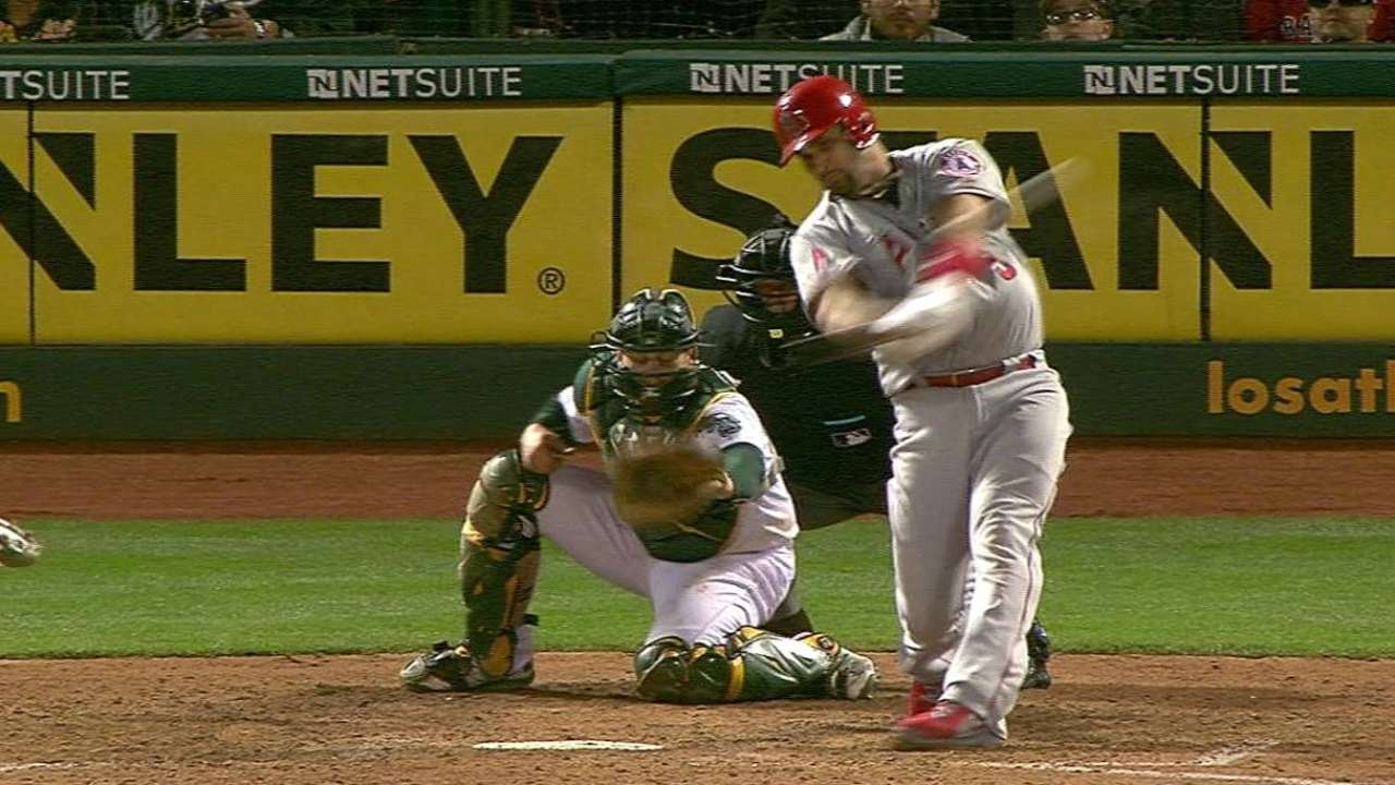 Pujols slams Angels past A's in 8-run seventh