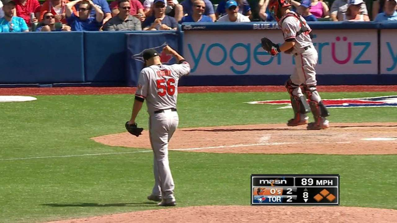 O'Day escapes bases-loaded jam