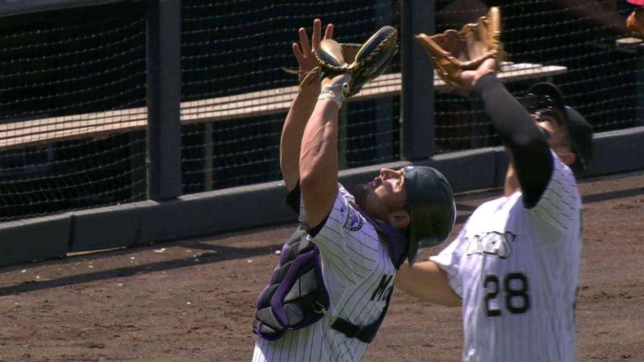 McKenry, Arenado collide for out