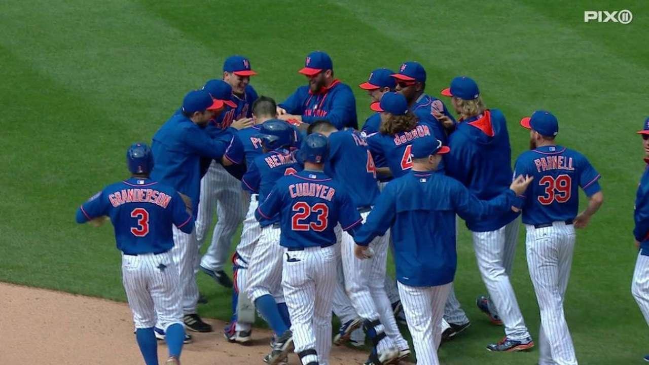 Mets ganan juego suspendido vs. Rojos en 13 entradas