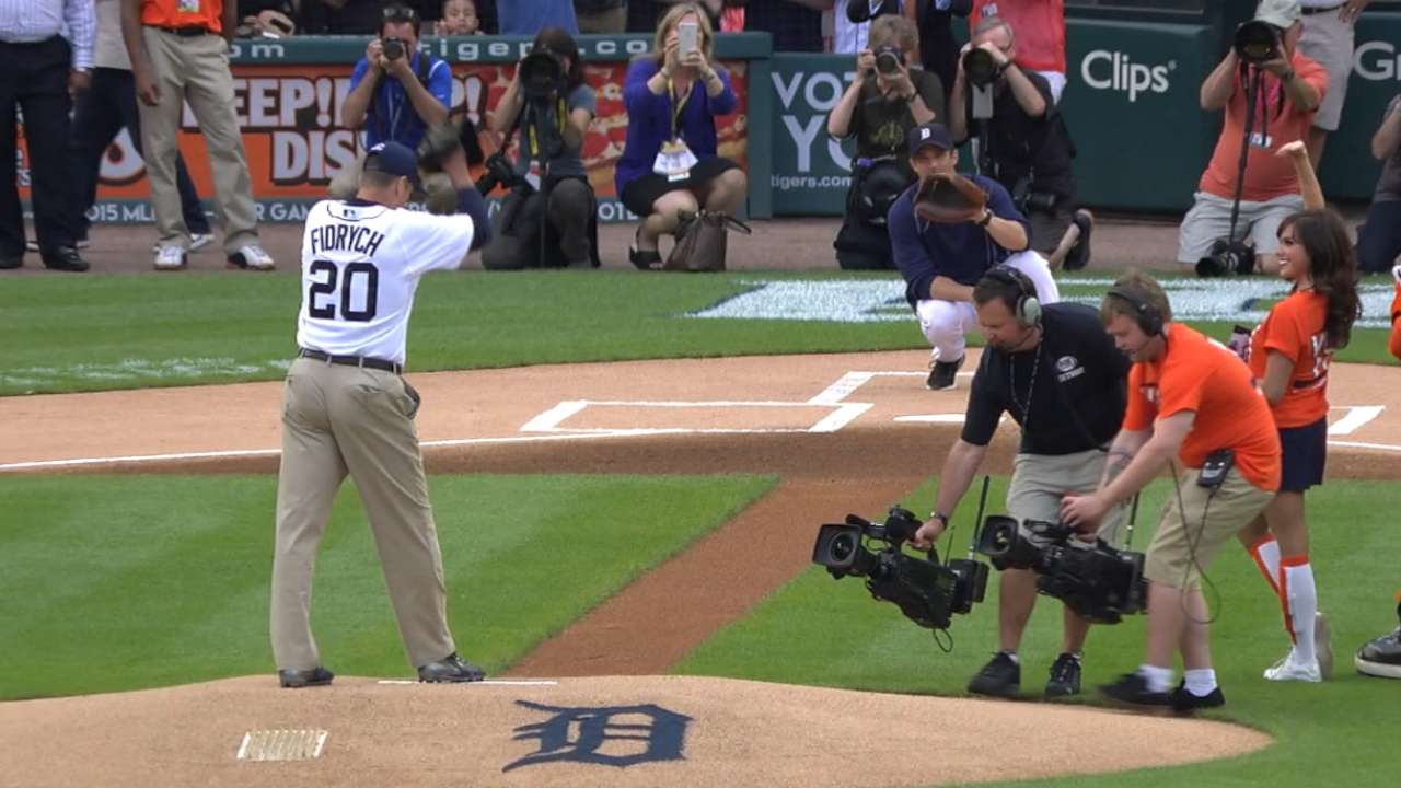 Harbaugh throws ceremonial first pitch