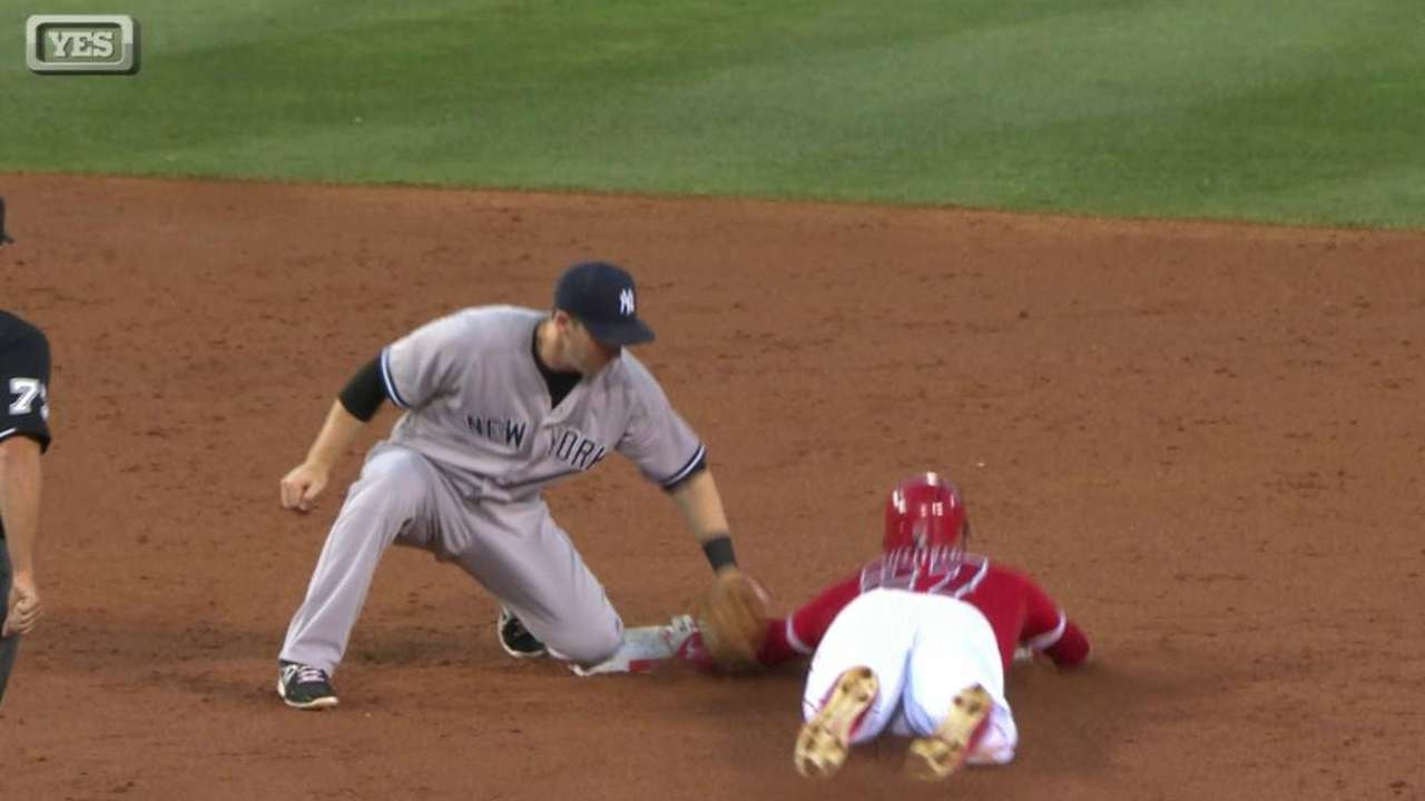 McCann nabs Trout, call stands
