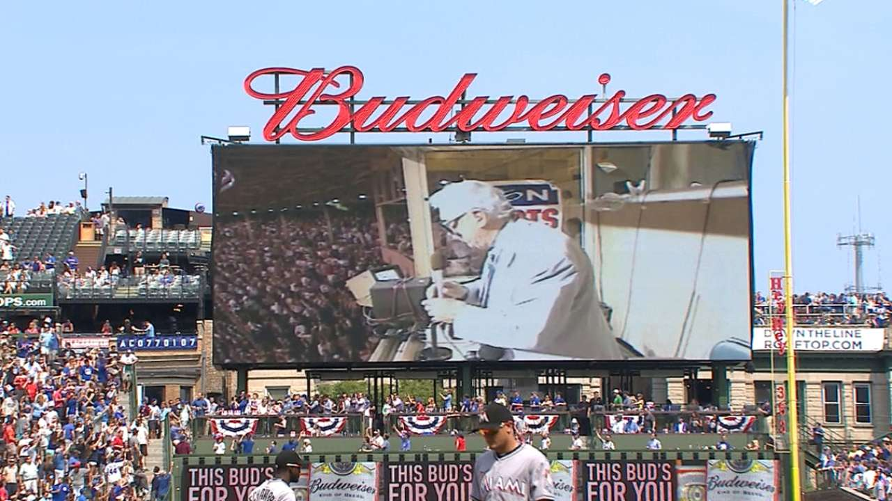 Caray sings during the 7th