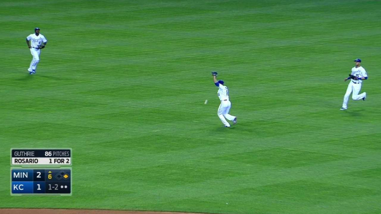 Rosario reaches on dropped ball