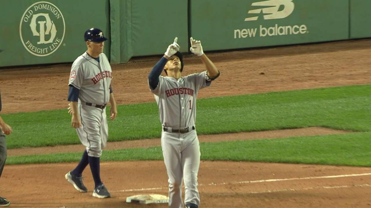 Correa's big hits help Astros outslug Boston
