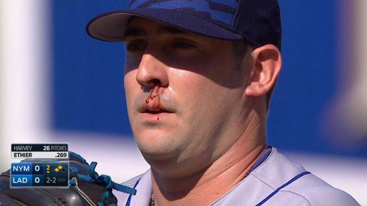 Harvey pitches with bloody nose