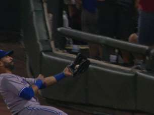 TOR@CWS: Bautista slides to make catch in foul ground