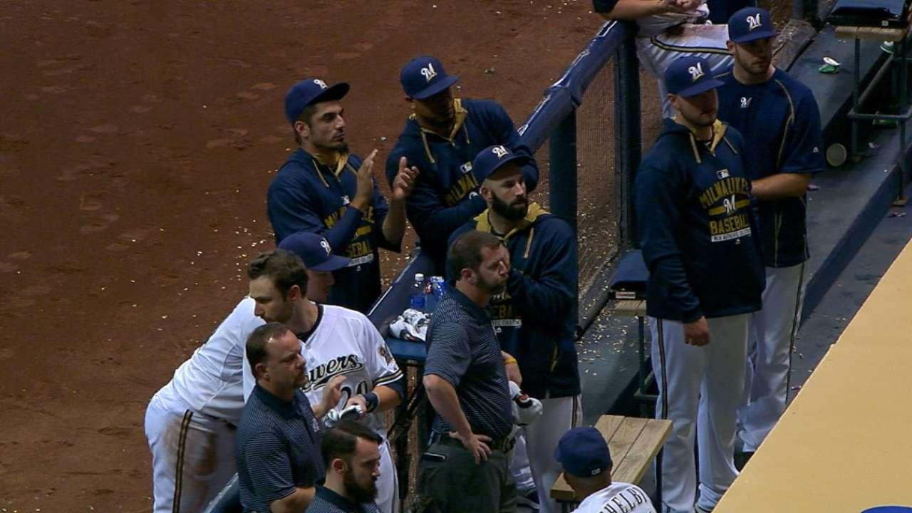 Braves, Brewers concerned for injured fan