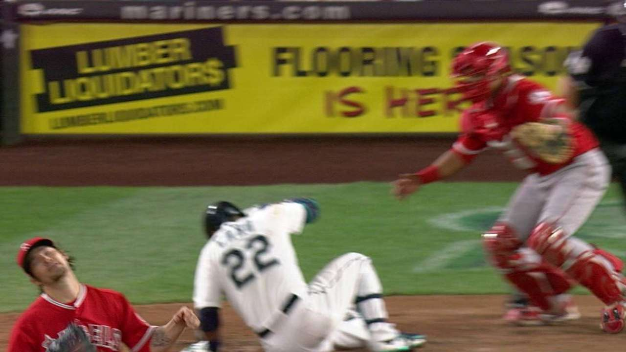 Cano hit by a pitch, stays in