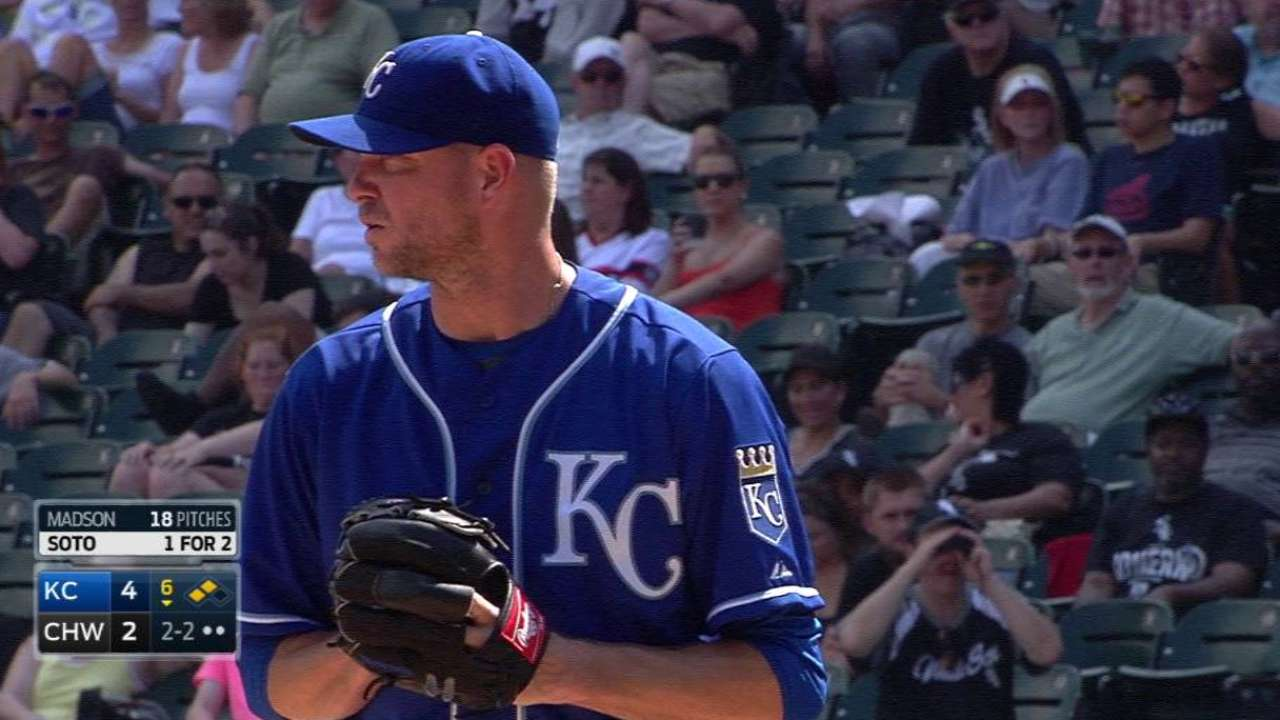 Madson strands two runners