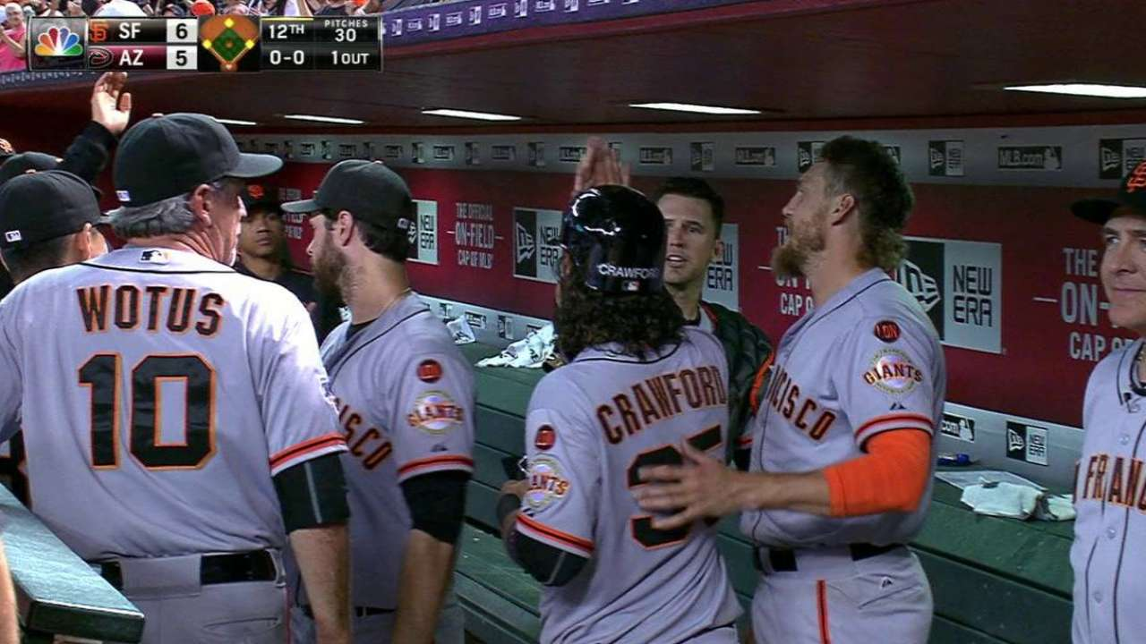 Giants pick up win on D-backs' error in 12th