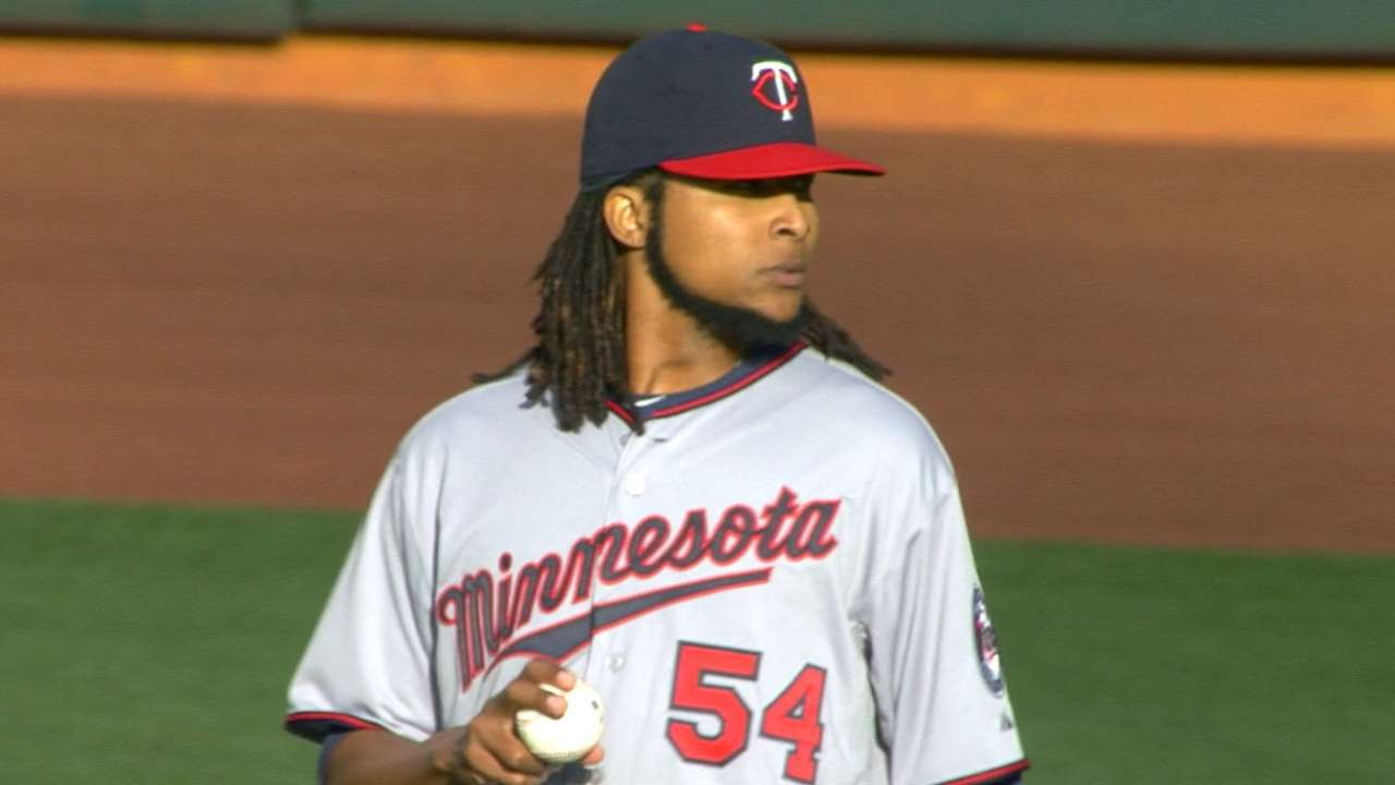 Santana looks sharp in first win with Twins