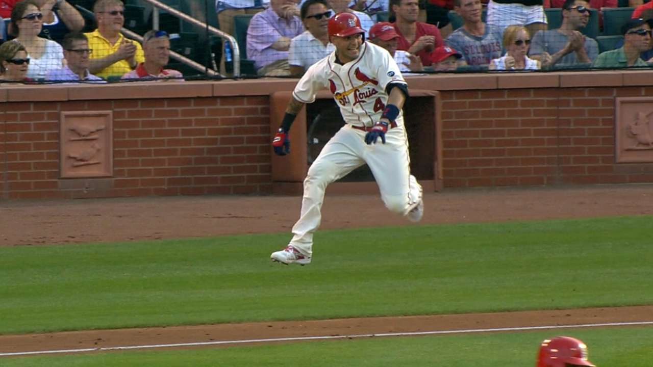 Cardinals score in bunches to rout Mets