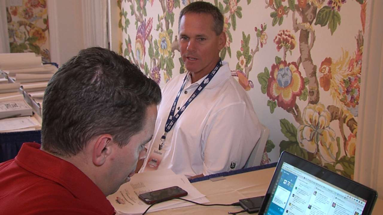 On induction's eve, Biggio embracing Hall fraternity