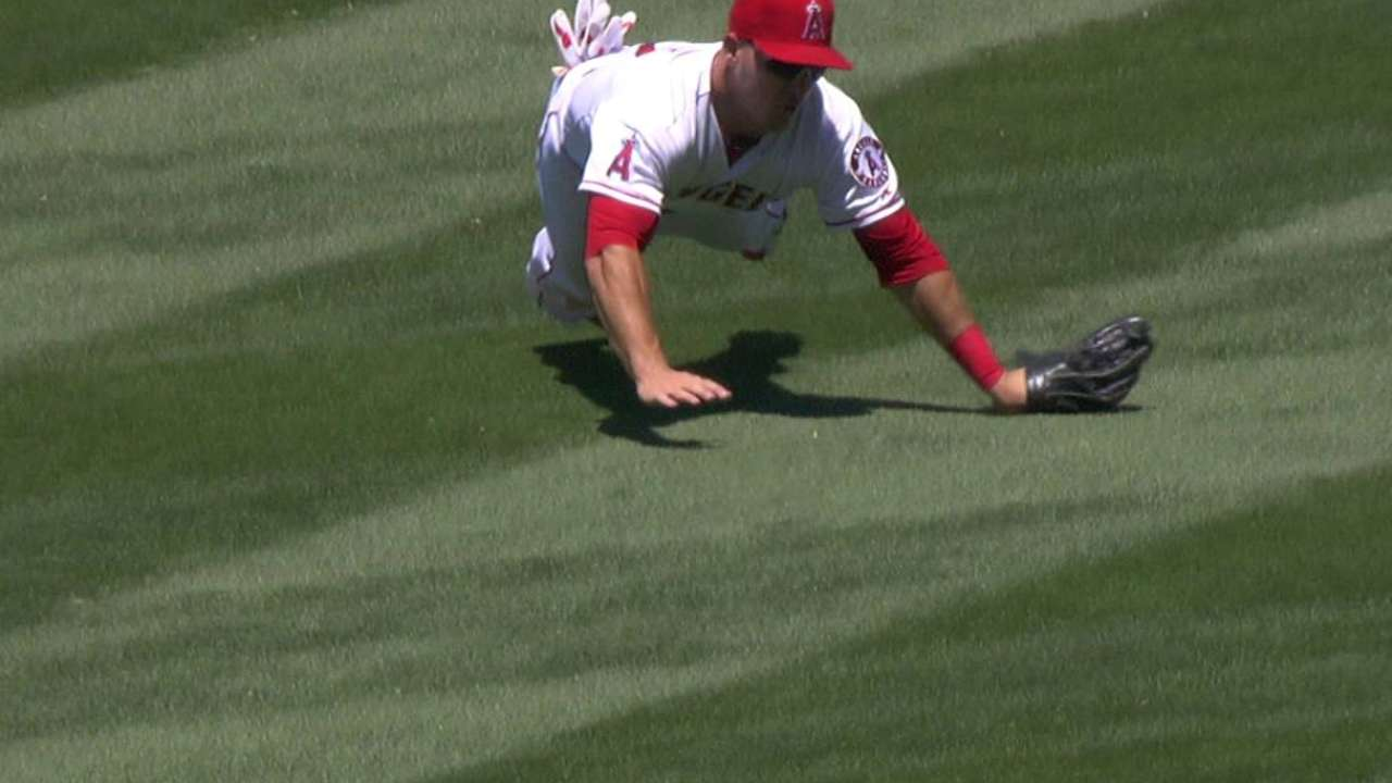 Trout returns to lineup after resting wrist