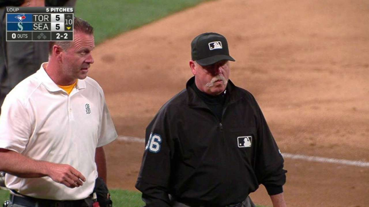 Umpire Joyce leaves the game