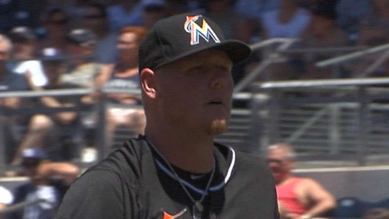 Latos drowns out trade talk in quality start
