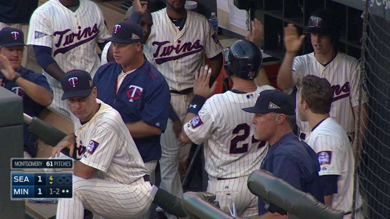 New father Plouffe back to work with Twins