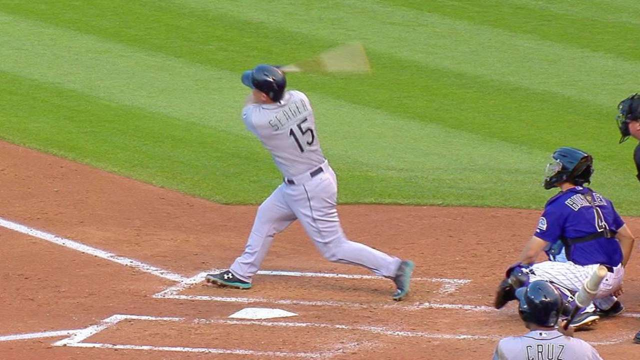 Powerful Mariners hold off Rockies rally