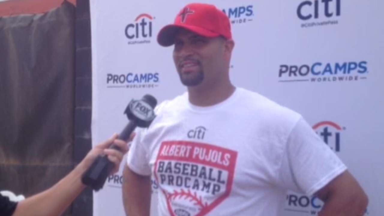 Pujols shares game's fundamentals with campers