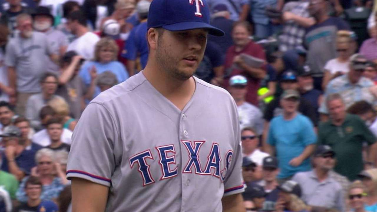 Tolleson's escape in 10th gives Texas huge lift