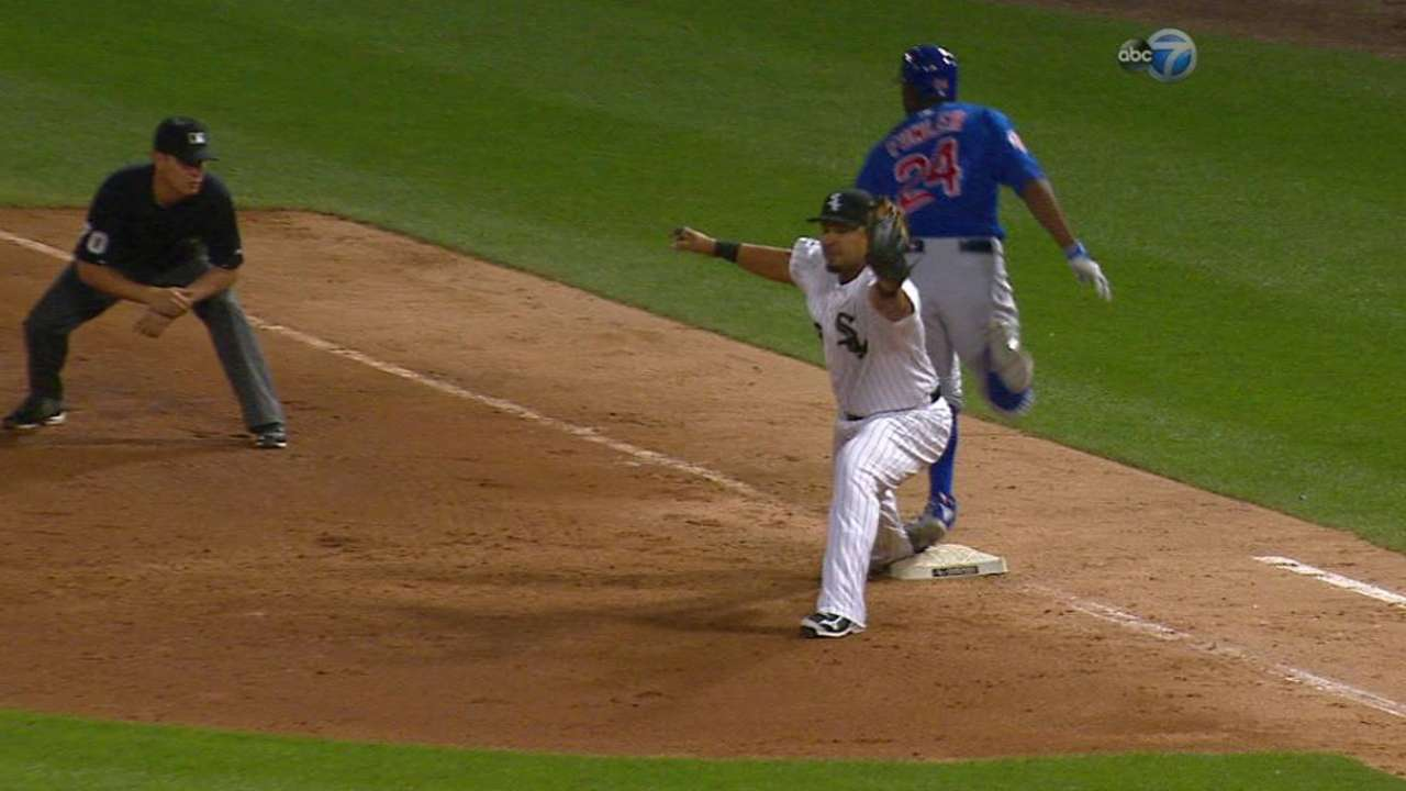 Fowler safe at first on review
