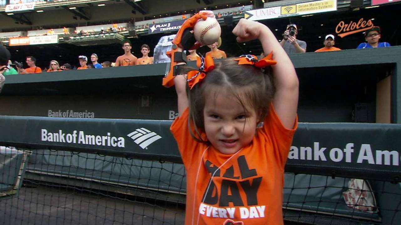 Orioles welcome girl for poignant first pitch