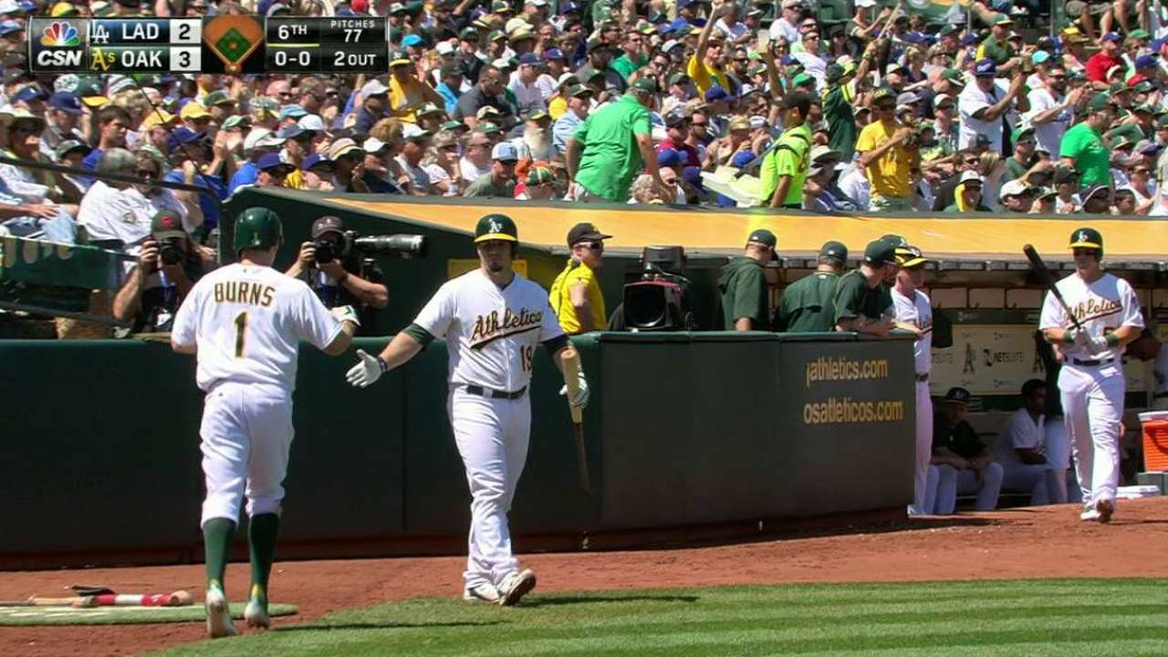 Chavez leads A's to sweep of Dodgers