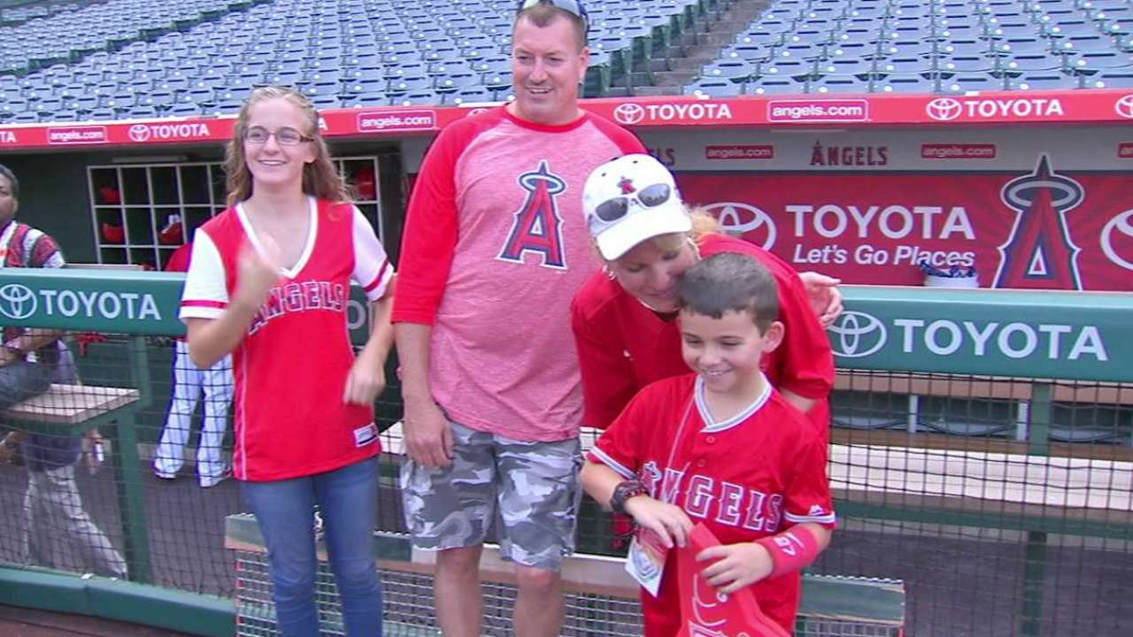 Trout meets with young fan
