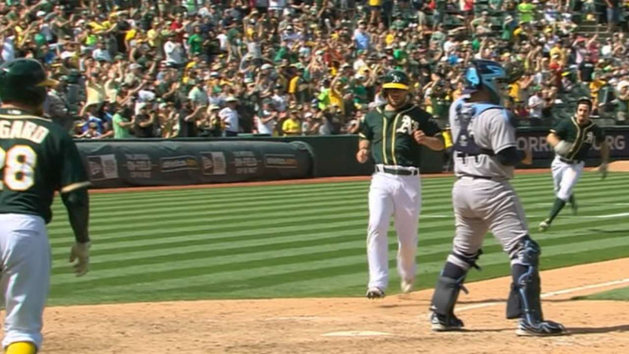 A's find groove in 7-run 7th, surge past Rays