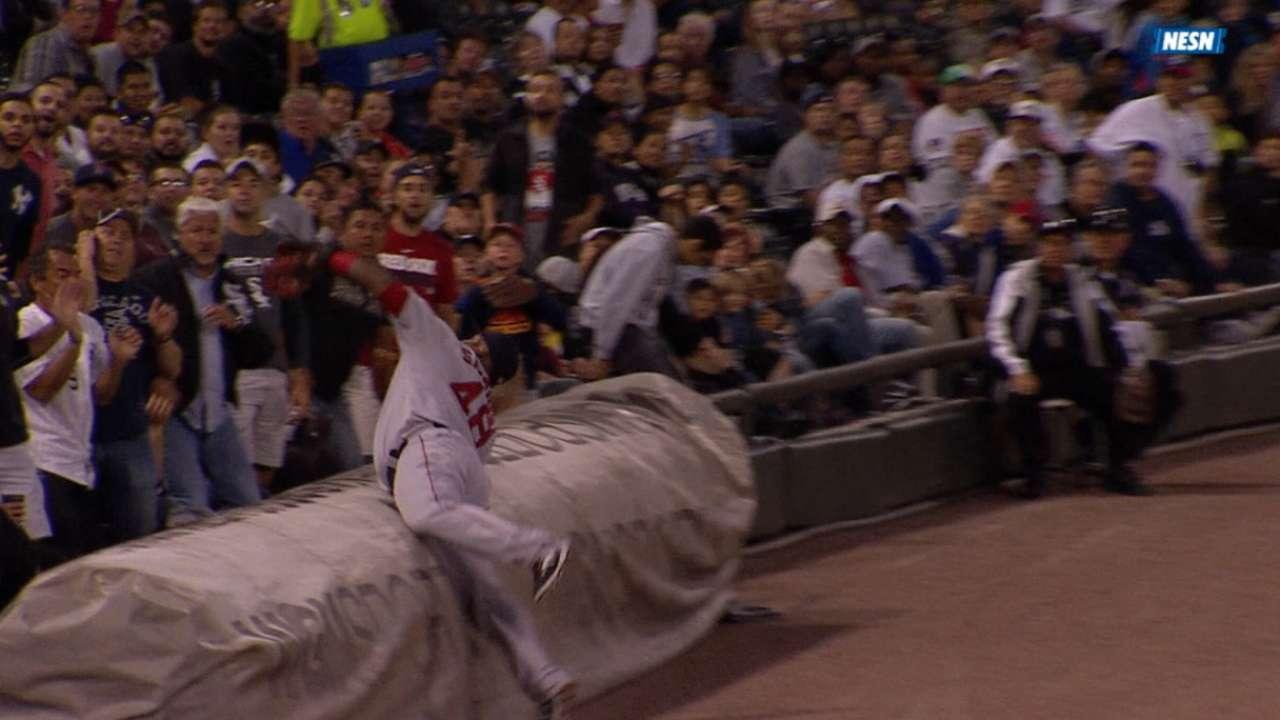 Must C: Sandoval dives on tarp