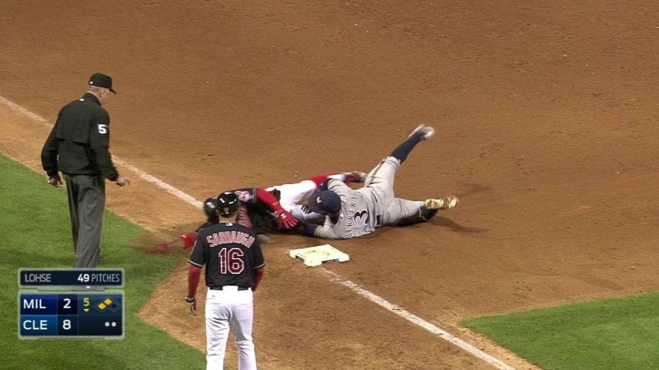Herrera dives to make the tag
