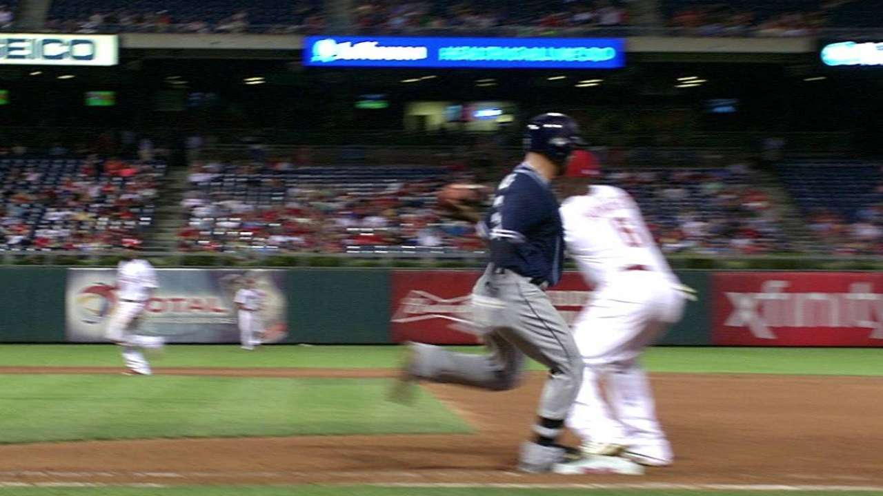 Alonso beats Galvis' throw