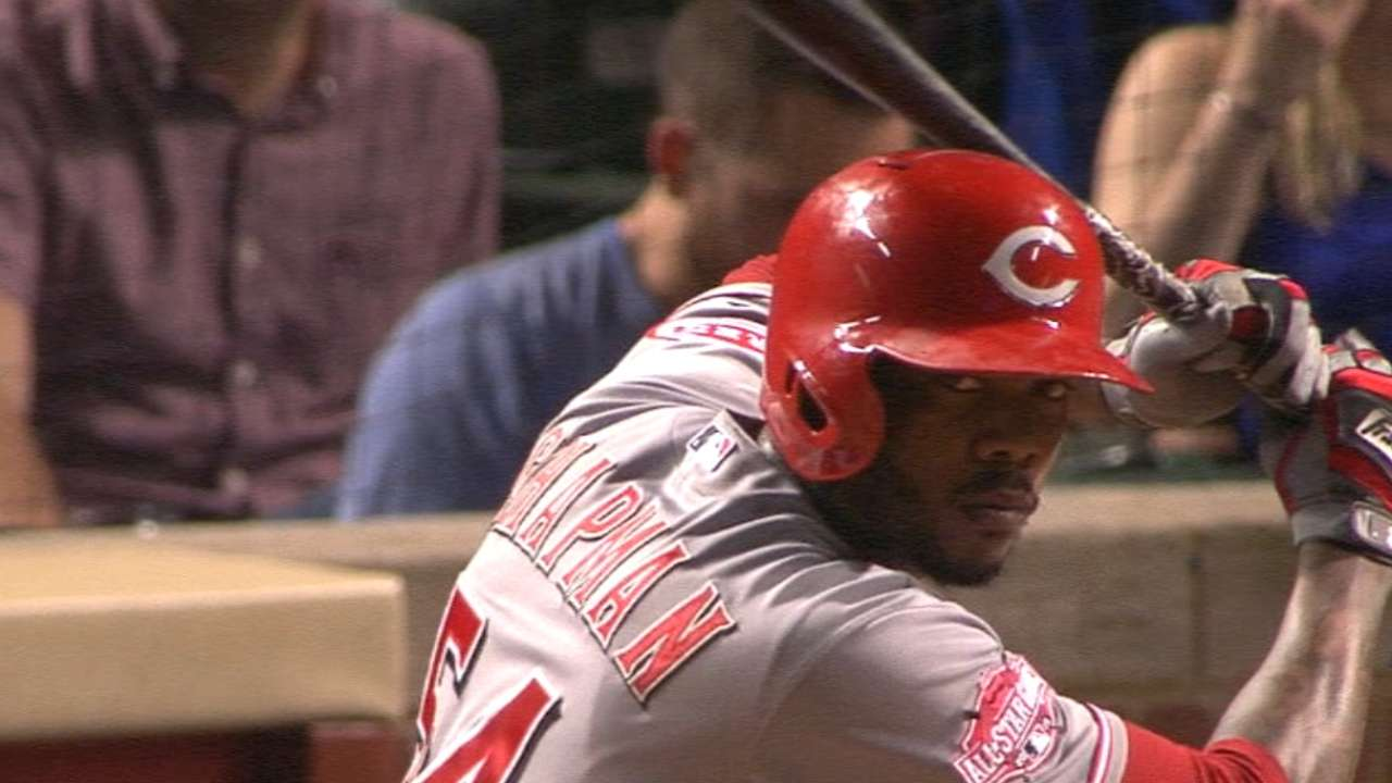 Reds bury Cubs with six-run ninth in opener