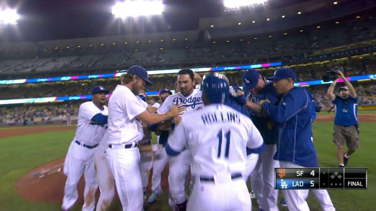 Adrian's walk-off ends clash with Giants in 14th