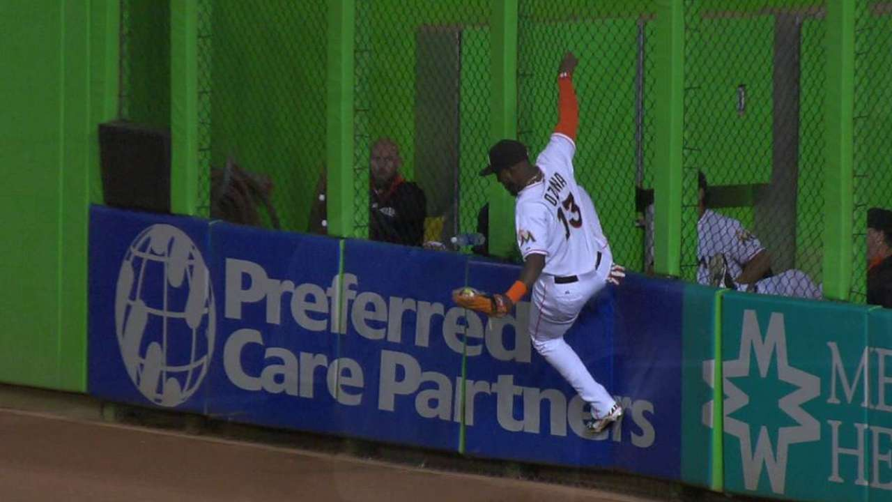 Ozuna climbs the wall for catch