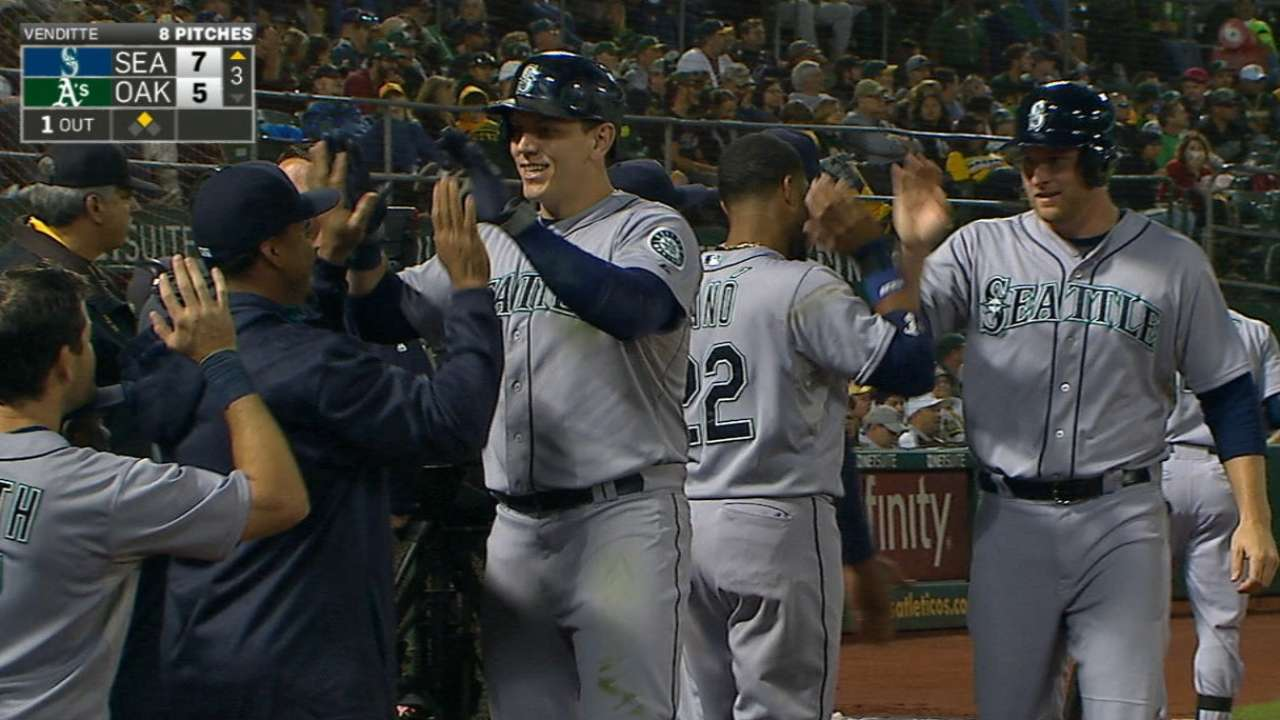 Mariners hang on to top A's in slugfest