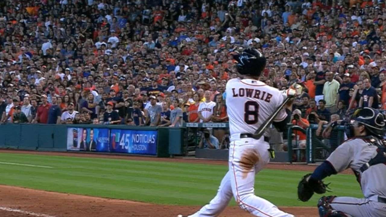 Lowrie hits go-ahead grand slam