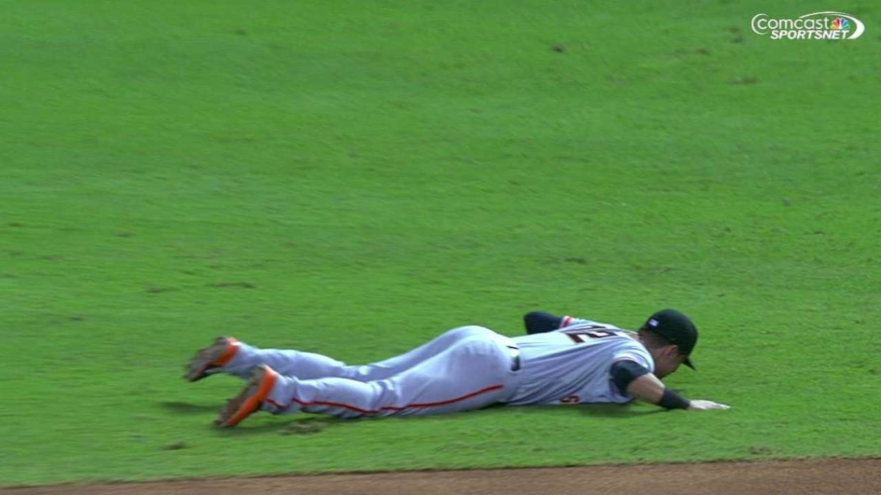 Panik's back issue flares up in loss to D-backs