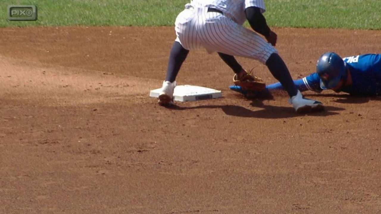 Yanks win challenge on pickoff