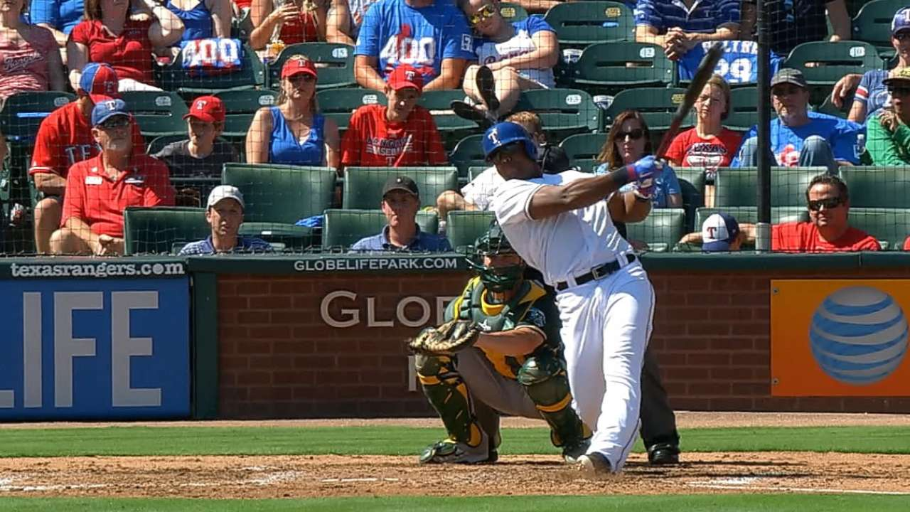 Rangers hit 4 HRs, keep pace out West