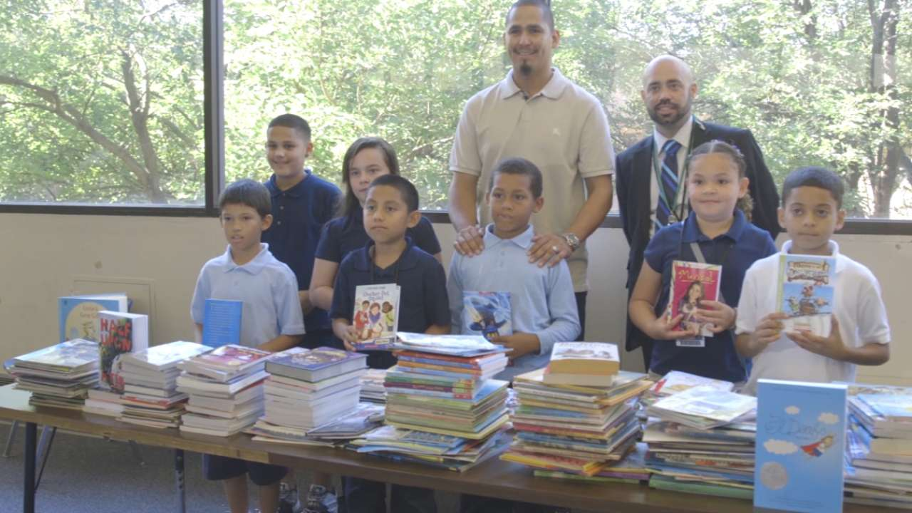 Carrasco hits the books with young students