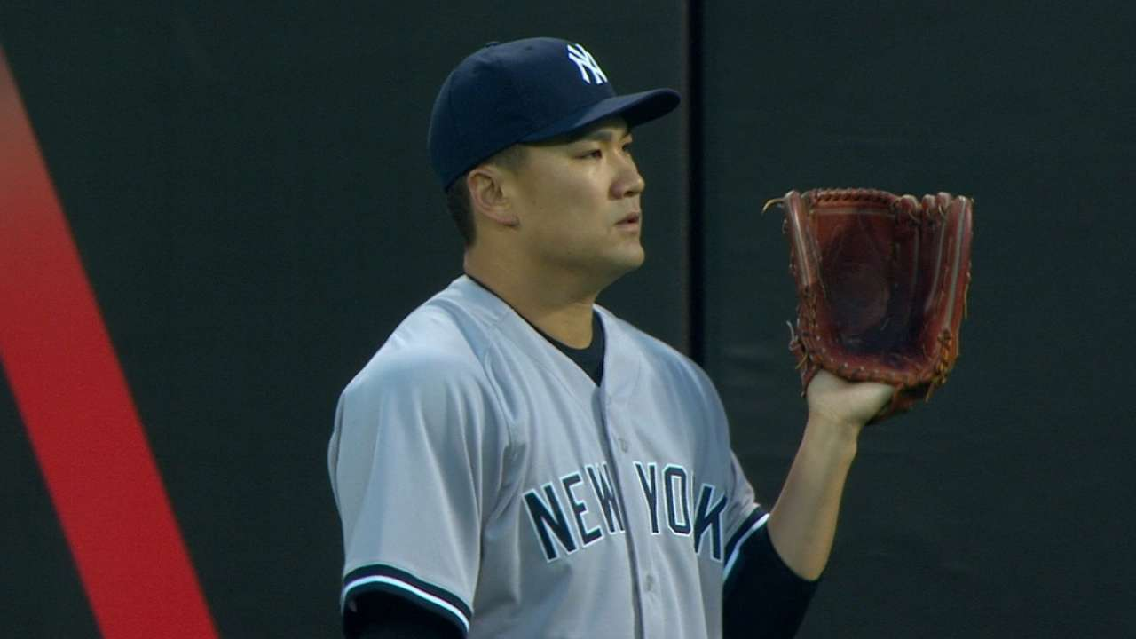 Tanaka holds Mets to two runs