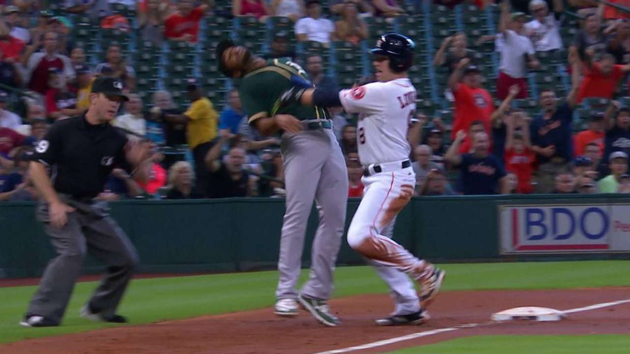 Lowrie shoves Semien and scores