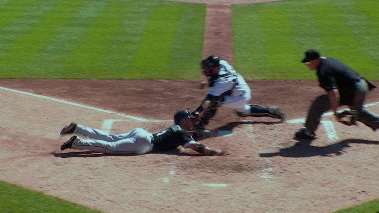 Sanchez slides home safely