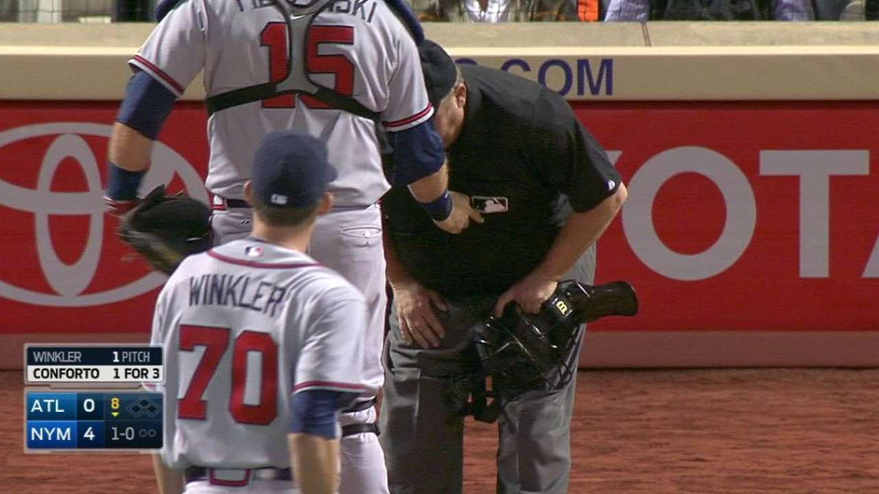 Winkler's first pitch hits ump