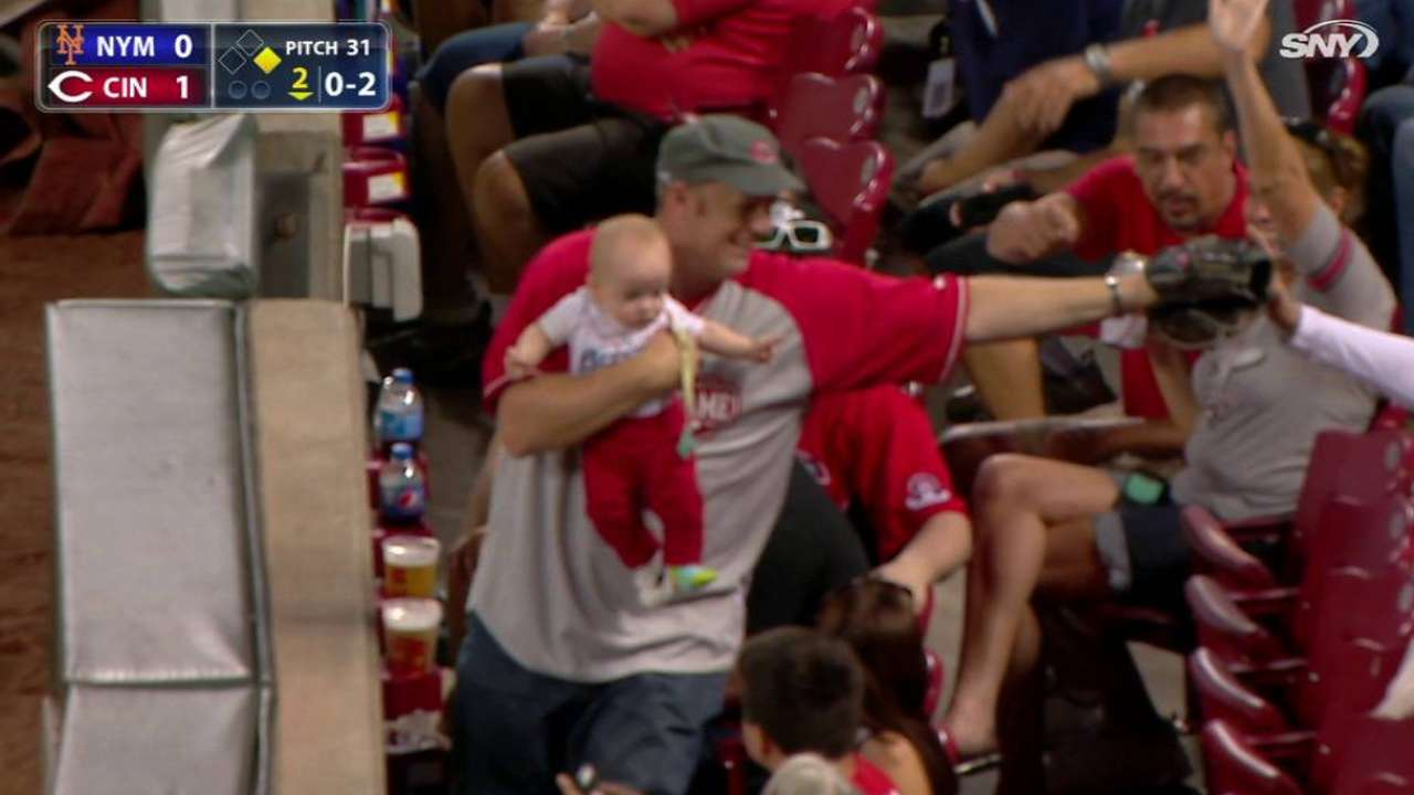 Dad snags foul with baby in arm
