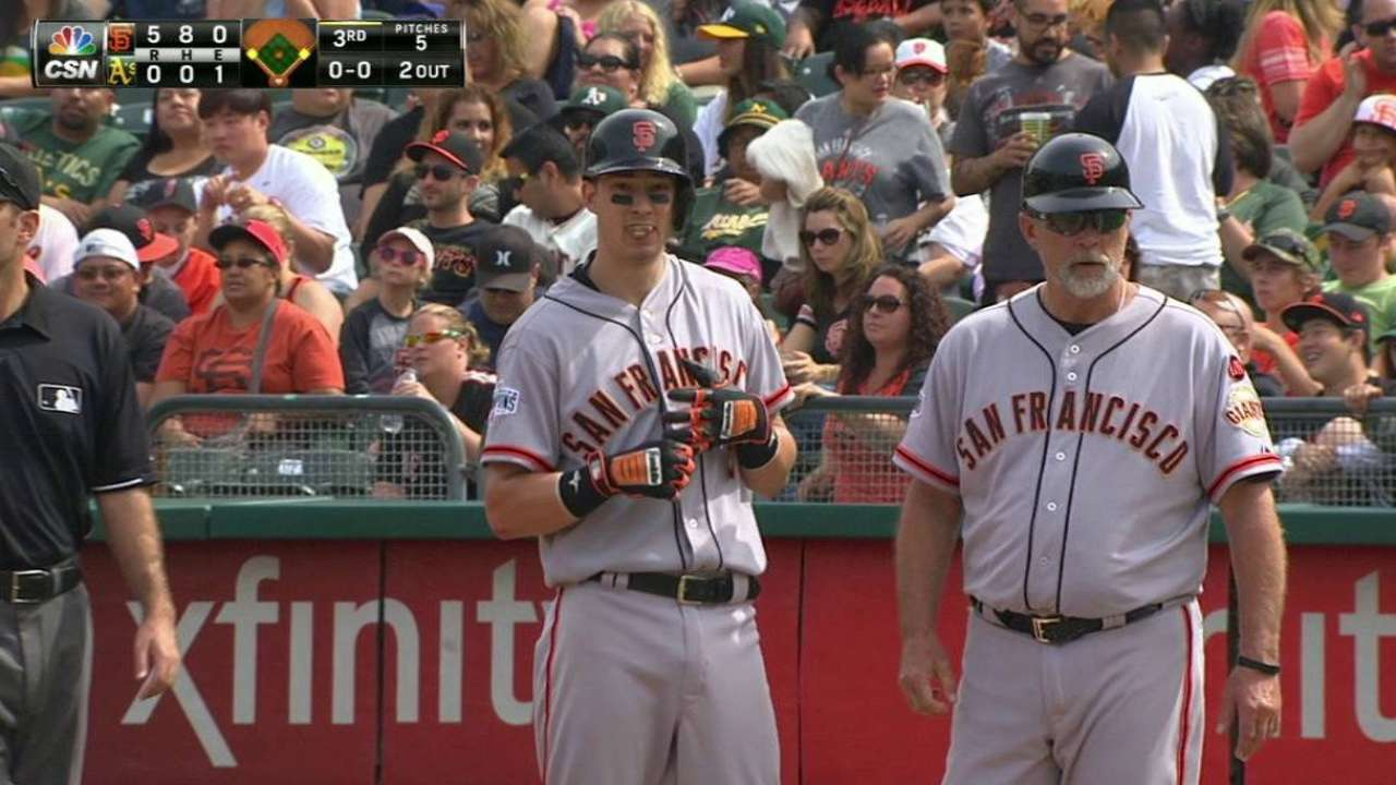 Giants edge A's, stay alive in NL West race