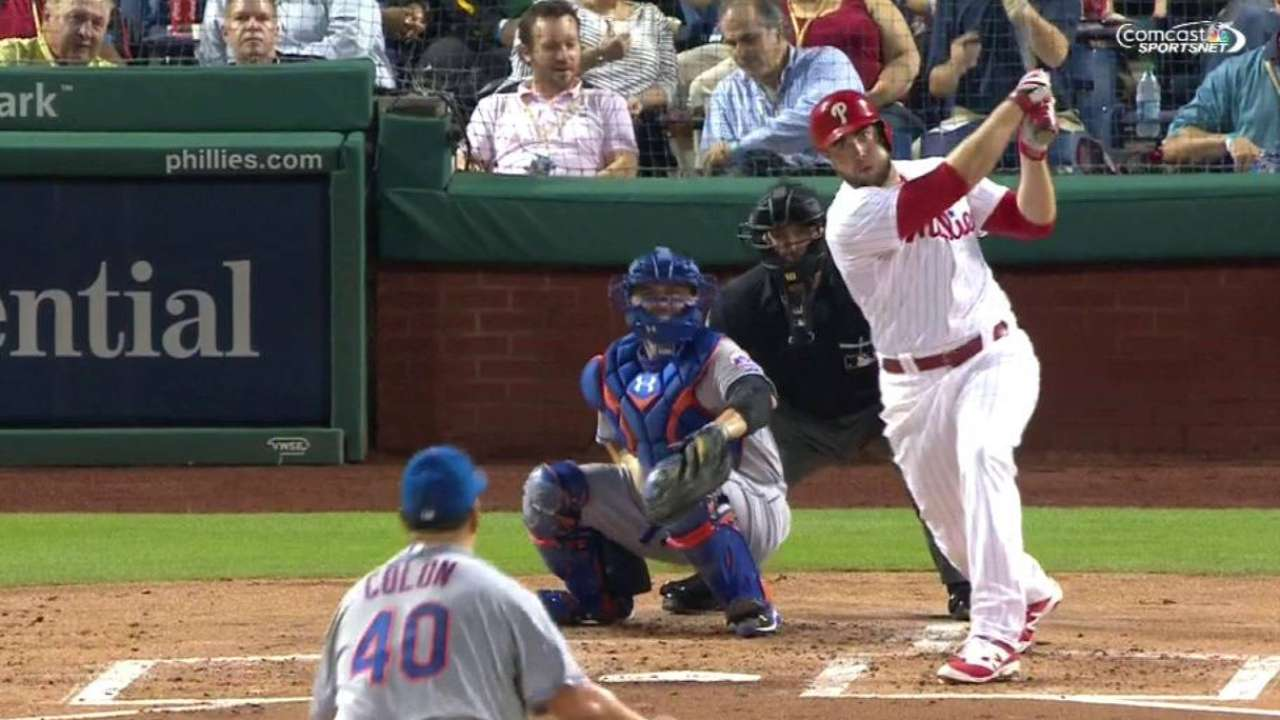 Phillies hold off Mets in ninth to take opener