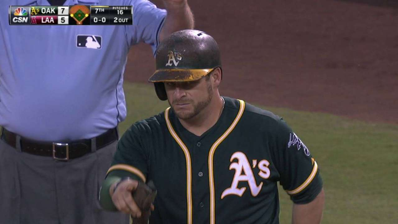 A's rally to slow Angels' postseason charge